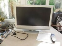 Marks & Spencer silver LCD digital colour TV with remote and instructions