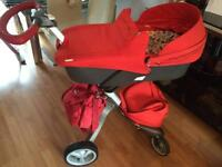 Stokke Xplory v4 pram/pushchair in red with lots of extras excellent condition