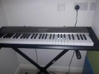 Casio Organ with light up keys to help learn & Stagg Stand