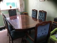 Lovely dining table and six chairs (2 carvers) side table included