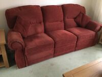 2 sofas. 1 230cm long 3 Seater with 2 recliners ,red moquette. 1 145cm long 2 seater .Both excellent