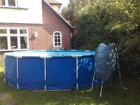 Outside Swimming Pool - The 15ft wide Intex Metal Frame Pool is 48 inches deep.