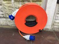 Caravan/Motorhome mains hook up cable with reel, 25mtr