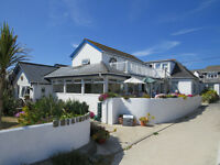 Beachside guest house, Isles of Scilly: waiting tables at breakfast, chamber-maiding & laundry