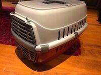 Small red/cream pet carrier