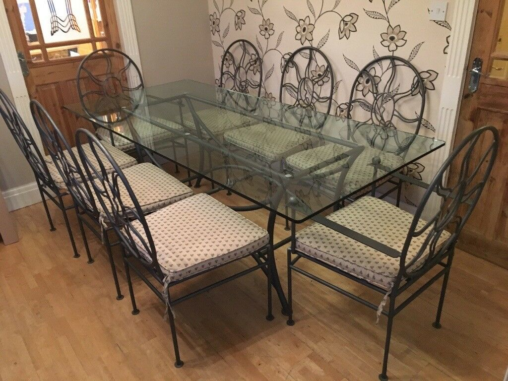 RARE WROUGHT IRON GLASS TOPPED TABLE WITH 8 CHAIRS