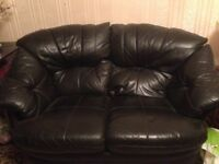 Two x Two Seater Black Leather Sofas