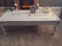 This is a beautiful solid wood shabby chic coffee table - painted in winter grey