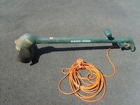 Black and Decker grass trimmer used and working. Long Cable. Spare replacement line.
