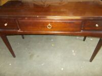 A STAG MINSTREL THREE DRAWER DRESSING TABLE