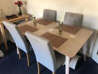 Oak dining table and 4 neutral coloured chairs