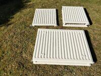 3 White central heating radiators