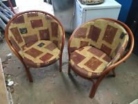Two wicker conservatory or patio chairs