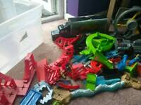 Box full of hot wheels track and sets/accesories
