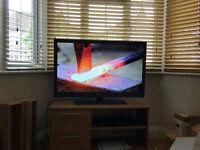"42"" HD Bush television, with TV unit and Panasonic Blu-Ray player"