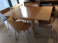 Extendable wooden dinning table with 4 maching chairs