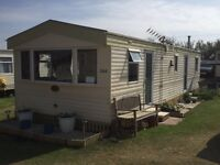 Static caravan for hire Harlyn Sands Holiday Park, Cornwall. Ideal for families-3 bedrooms, sleeps 8