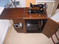 1938 Singer Sewing Machine, in cabinet with treadle