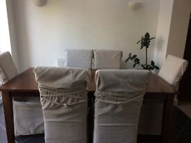 Six seater dining table and chairs