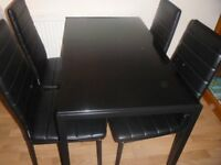 Black Glass Dining Set with 4 chairs Used in great conditions- local collection BR3 £40