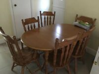 Extending solid wood dining table and 6 chairs - £80