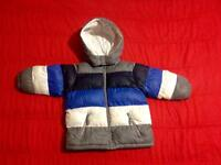 The children place winter jacket