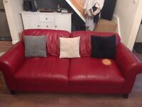 Red DFS three piece suite. 3 seater sofa, arm chair and footstool with storage.