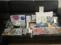 Nintendo Wii Family Bundle with 23 games and accessories