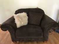 Large brown sofa and loveseat. Extremely comfortable and in great condition. All cushions inc. fqs