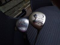 2 Taylor Made Golf drivers.