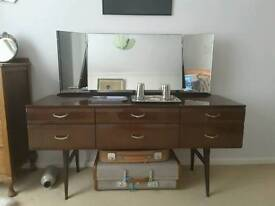 Elegant mid-century dressing table in dark wood with French polish.