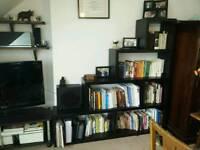 Large black step-style bookshelf