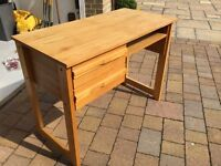 Small solid wooden desk suitable for a child. Would benefit from repolish or paint.