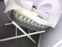 Moses basket with foldable stand.
