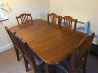 Wooden veneer six place dining table and chairs