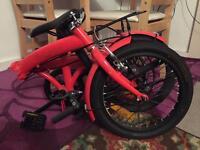 Red Fellia folding bike