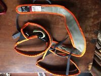 One large Petzl harness, one Petzl GRIGRI belay device and one Carabina