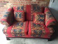 Indian motif sofa with matching cushions