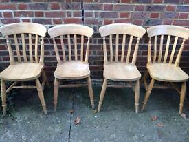 4 farmhouse-style pine chairs