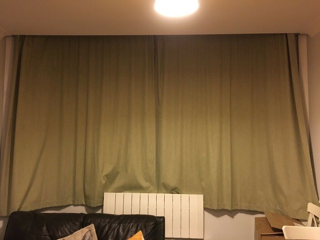 Beautiful pair grass green Dunelm curtains. Each curtain measures 228x228cm.