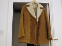 Mens Sheepskin coat Used. Light brown tan colour. 38/40 inch chest x 30 inch length.