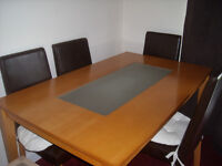 Dining table @4 brown faux leather chairs.