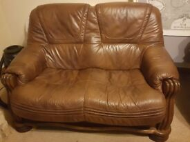 Two seater leather and wood base settee