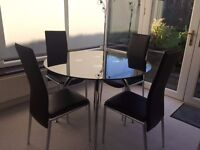 Black glass top dining table and chairs