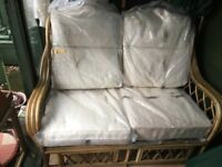 Unused Two seater Wicker wood conservatory sofa with cream cushions - FREE table