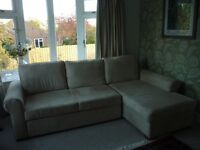 Cream Corner Sofa Bed. In faux suede fabric. very clean.