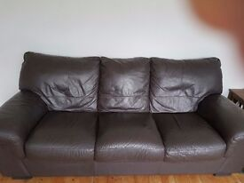 2 x 3 seater brown leather sofas with matching footstool