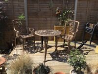 Antique effect garden table and chairs.
