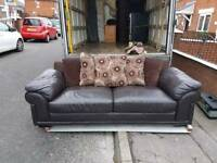 Reid's 4 seater leather and material sofa