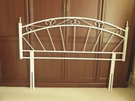 White double bed headboard with brass coloured finials